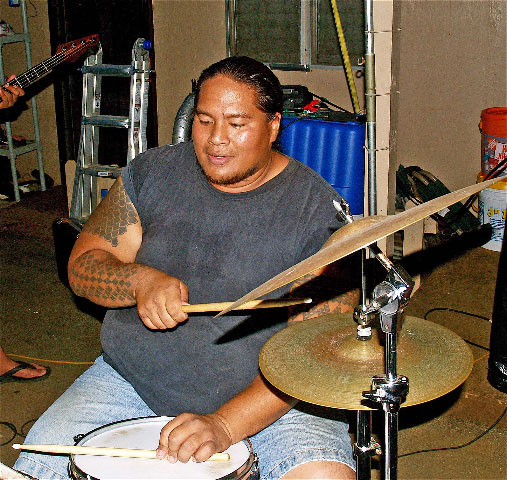 Bumpy Kanahele's son Wes playing the drums.